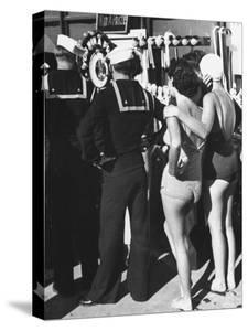 Girls in Bathing Suits Standing on Boardwalk with Sailors Who are on Leave by Peter Stackpole
