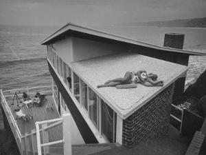 Guests Playing Cards and Sunbathing at Cliffside Home of W. M. MacConnell by Peter Stackpole