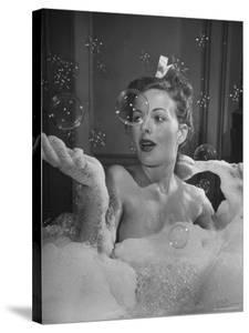 Jeanne Crain Taking Bubble Bath for Her Role in Movie Margie by Peter Stackpole