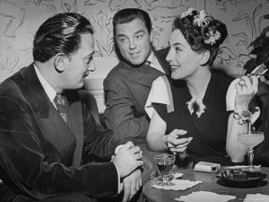 Joan Crawford Chatting with Artist Salvador Dali at Del Monte Resort by Peter Stackpole