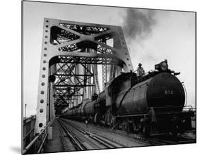 Long String of Tank Cars Rumbling Across the 4 1/2 Mile Huey Long Bridge at New Orleans by Peter Stackpole