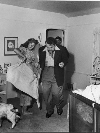 Married Actors Orson Welles and Rita Hayworth Pretending to Bullfight at Home