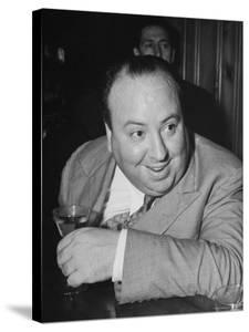 Movie Director Alfred Hitchcock Sits at Chasen's Bar While Enjoying a Cocktail Hour by Peter Stackpole