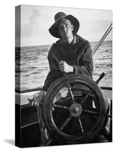 Newport Bermuda Sailing Race: Young Man Attending the Wheel of a Sailboat by Peter Stackpole