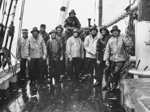 Nova Scotia Fishermen Gathering for a Picture While at Sea Off Grand Banks by Peter Stackpole