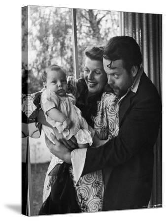 Orson Welles, Wife Rita Hayworth and Infant Daughter Rebecca at Home