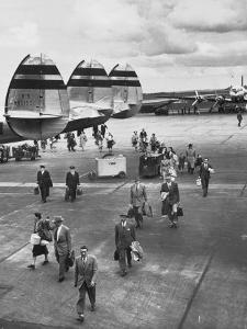 Passengers Leaving a Twa Flight at the Airport by Peter Stackpole