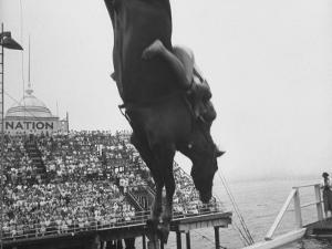 People Come Out to See the Diving Horse by Peter Stackpole