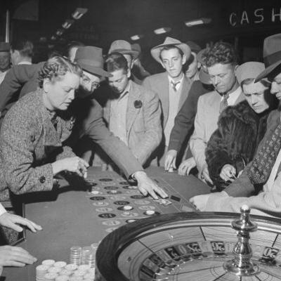Playing the Roulette Wheel in a Las Vegas Club by Peter Stackpole