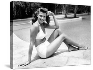 Rita Hayworth Posing in White Two Piece Bathing Suit by Peter Stackpole
