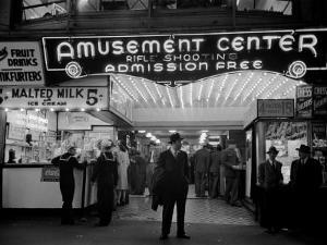 Sailors and Civilians Outside a Brightly Lit Times Square Arcade During WWII by Peter Stackpole