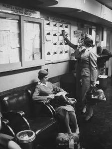 Stewardess Signing in for Flight by Peter Stackpole