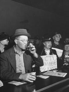 Women's Christian Temperance Union Members Raiding Local Bar Carrying Signs by Peter Stackpole