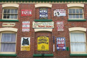 Advertisements on a Building, Ross-On-Wye, Herefordshire by Peter Thompson