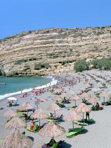 Beach and Caves, Matala, Crete, Greece by Peter Thompson