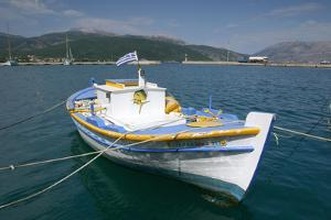 Boat in the Harbour of Sami, Kefalonia, Greece by Peter Thompson