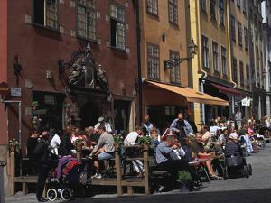 Café and Colourful Houses, Stortorget Square, Stockholm, Sweden by Peter Thompson