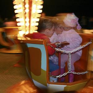 Children on a fairground ride, 2005 by Peter Thompson