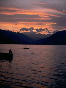 Fishing at Sunset, Lake Maggiore, Italy by Peter Thompson