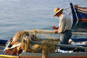 Man on Board a Fishing Boat, Sami, Kefalonia, Greece by Peter Thompson