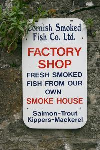 Sign advertising smoked fish, Charlestown, Cornwall by Peter Thompson