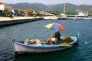 Small Fishing Boat in the Harbour, Sami, Kefalonia, Greece by Peter Thompson