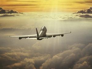 Airplane Flying in Sky by Peter Walton