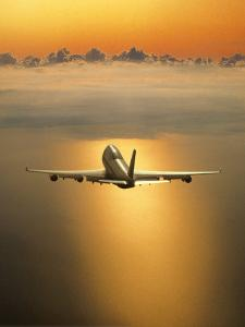 Airplane Flying Through Clouds by Peter Walton