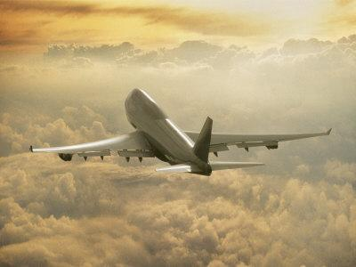 Jumbo Jet Above Clouds at 35,000 Feet