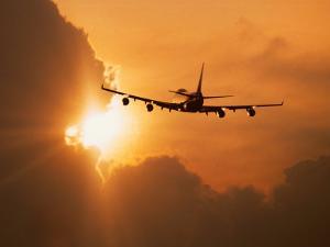 Jumbo Jet Banking Into Sunset by Peter Walton