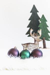 A Christmas Decoration Made of Wood, Fir Trees with Reindeer and Christmas Balls by Petra Daisenberger
