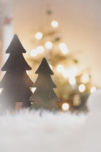 A Christmas Decoration with Christmas Tree in Warm Atmosphere by Petra Daisenberger