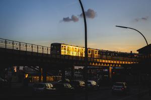 Hamburg - a Subway Car Driving over a Bridge at Sundown by Petra Daisenberger
