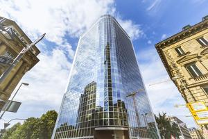 The Blue Sky Is Reflecting in a Glass Front of a High Rise by Petra Daisenberger