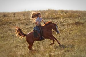 Beautiful Girl Riding a Horse  in Countryside. by PH.OK