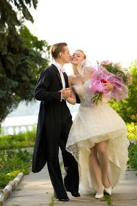 Colorful Wedding Shot of Bride and Groom Kissing by PH.OK
