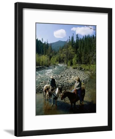 Horseback Riders Stand in Coffee Creek