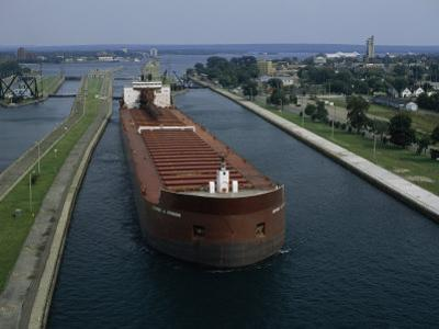 Ore Freighter Ship Exits the Soo Locks on the St. Mary's River, Michigan