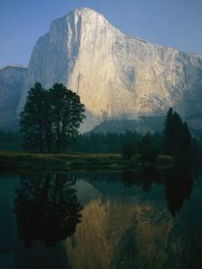 The Sunlit Face of El Capitan is Reflected in the Merced River by Phil Schermeister