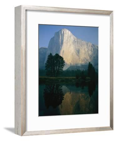 The Sunlit Face of El Capitan is Reflected in the Merced River