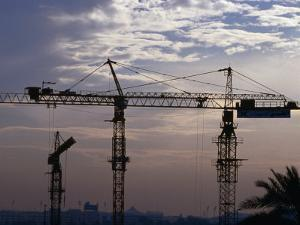 Construction Site Cranes at Sunset, Dubai, United Arab Emirates by Phil Weymouth
