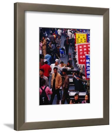 Crowds on Wangfujing Street in Dongcheng Bejing, China