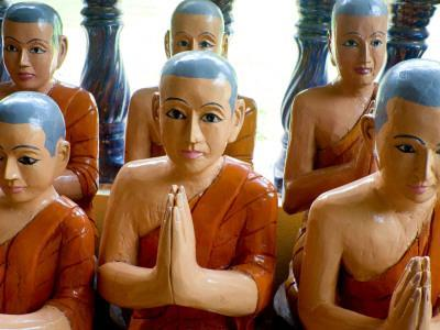 Statuettes of Buddhist Monks at Prayer