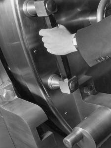 A Man Closes a Large Bank Vault by Philip Gendreau