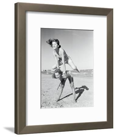 Girls Playing Leapfrog on Beach