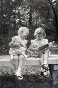 Two Little Girls Sitting on a Bench by Philip Gendreau