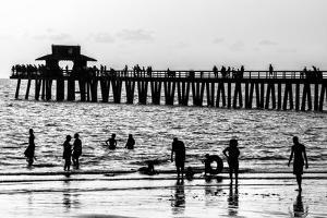 Beach Scene - Naples Florida Pier at Sunset by Philippe Hugonnard