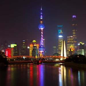 China 10MKm2 Collection - Shanghai Skyline with Oriental Pearl Tower at night by Philippe Hugonnard