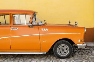 Cuba Fuerte Collection - Close-up of Retro Orange Car by Philippe Hugonnard
