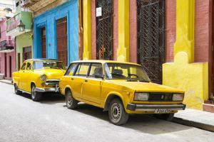 Cuba Fuerte Collection - Two Yellow Cars in Havana by Philippe Hugonnard